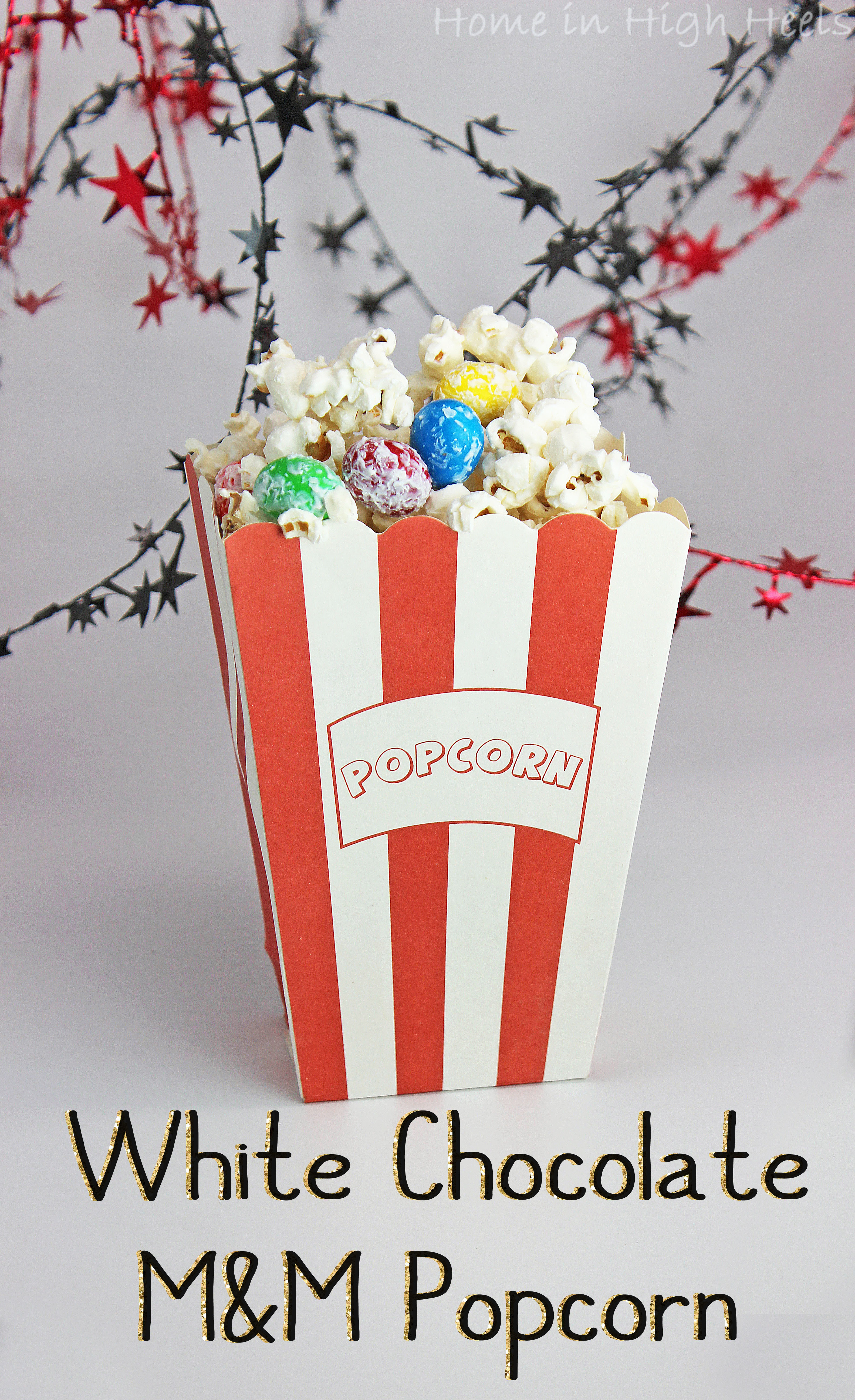 This White Chocolate M&M Popcorn Recipe is the Perfect Mix for Parties! Get party ready FAST with this kid-friendly adult-pleasing snack mix that you can really customize! from Home in High Heels