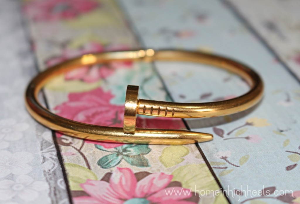Add Some Construction to Your Look With this Nail Bracelet! This is a fun industrial touch that adds some glam without being the high price of Cartier. Check it out along with other lifestyle posts on Home in High Heels   www.homeinhighheels.com
