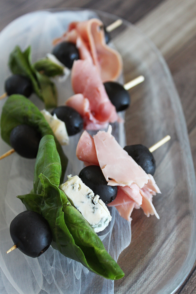 The Anti-Salad Healthy Appetizer Skewers Recipe- this one includes gorgonzola, ham, black olives, & basil but there are lots of ways to customize! Check out more ideas on Home in High Heels