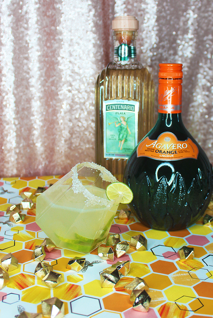 A homemade zesty citrus (lime & orange!) margarita recipe enhanced with raw honey for the perfect tart alcoholic drink on Home in High Heels