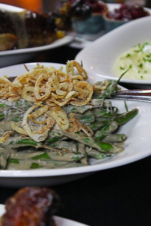 """Searsucker Thanksgiving Crispy Green Beans Shallots Recently the Vegas Lifestyle Influencers had the opportunity to hop on over to Searsucker & enjoy a thanksgiving feast! Never been to Searsucker? The restaurant is located inside Caesars Palace on the Las Vegas Strip. It has a bit of a retro, unique vibe with seriously cool, eclectic accents. The food is described as """"new American"""" & most of the items on the menu are completely unique or have a fun twist. Ready to see what they served up for an ALMOST traditional Thanksgiving meal? Keep reading to check it out on Home in High Heels"""