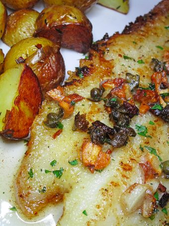 SOLE MEUNIèRE Panseared sole in brown butter with garlic, capers, lemon and parsley Black, White, Red, & French! Oh La La Bistro Restaurant Recap in Las Vegas with Christmas in Paris Little Red Dress Curvy OOTD on Home in High Heels